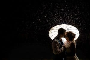 Wedding Photo of a couple photographed in rain at Dodford Manor