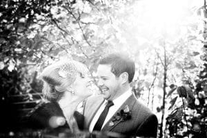 Bride and Groom sharing a funny moment. Natural wedding photography Northamptonshire