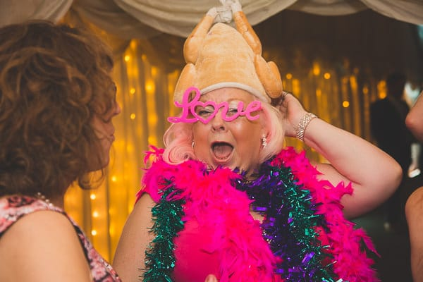 Mother of the wearing a chicken head at a wedding reception held at Crockwell Farm Wedding