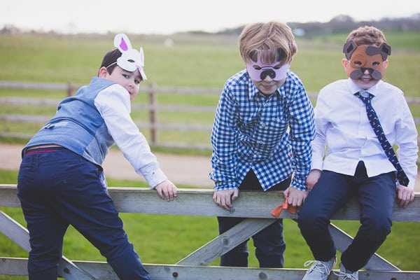Wedding guests playing on a gate at Dodford Manor