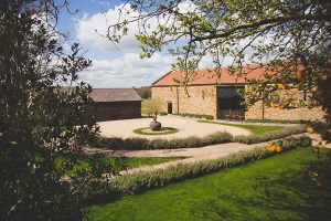 Dodford Manor Wedding Venue front courtyard on a beautiful spring day
