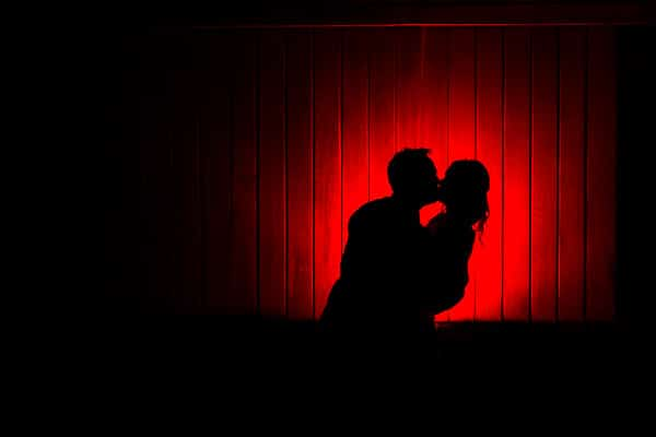 Bride and Groom Kissing creating a silhouette. Magmod off camera flash effect