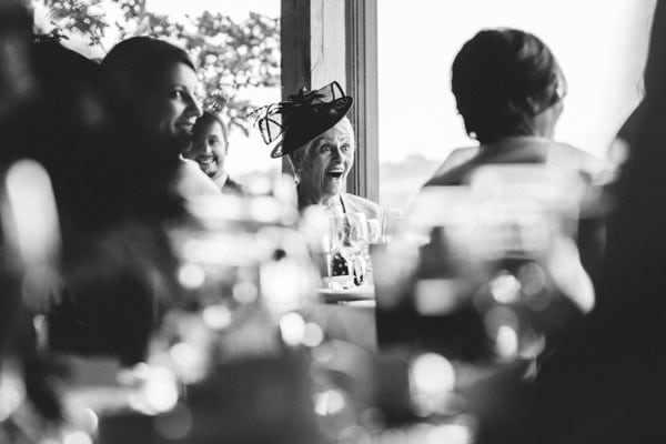 Mother of the Bride looking surprised during the speeches at a Dodford Manor Wedding