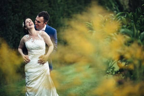 Wedding Couple laughing together at a DIY Wedding in Northamptonshire
