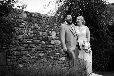 Dodford Manor Wedding Photos Couple laughing in the grounds Black and white photo