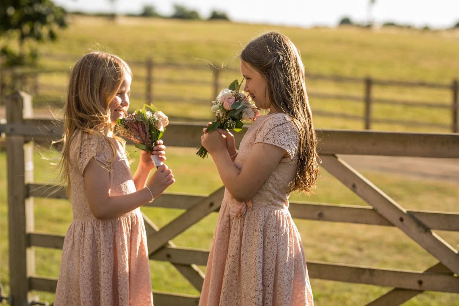 Flower Girls smelling there flowers