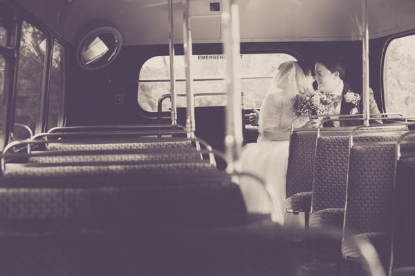 Stanwick Hotel review and couple sitting at the back of a vintage double decker bus kissing