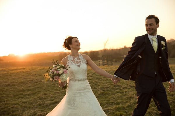 Sunset photo of couple giving a Dodford Manor wedding review