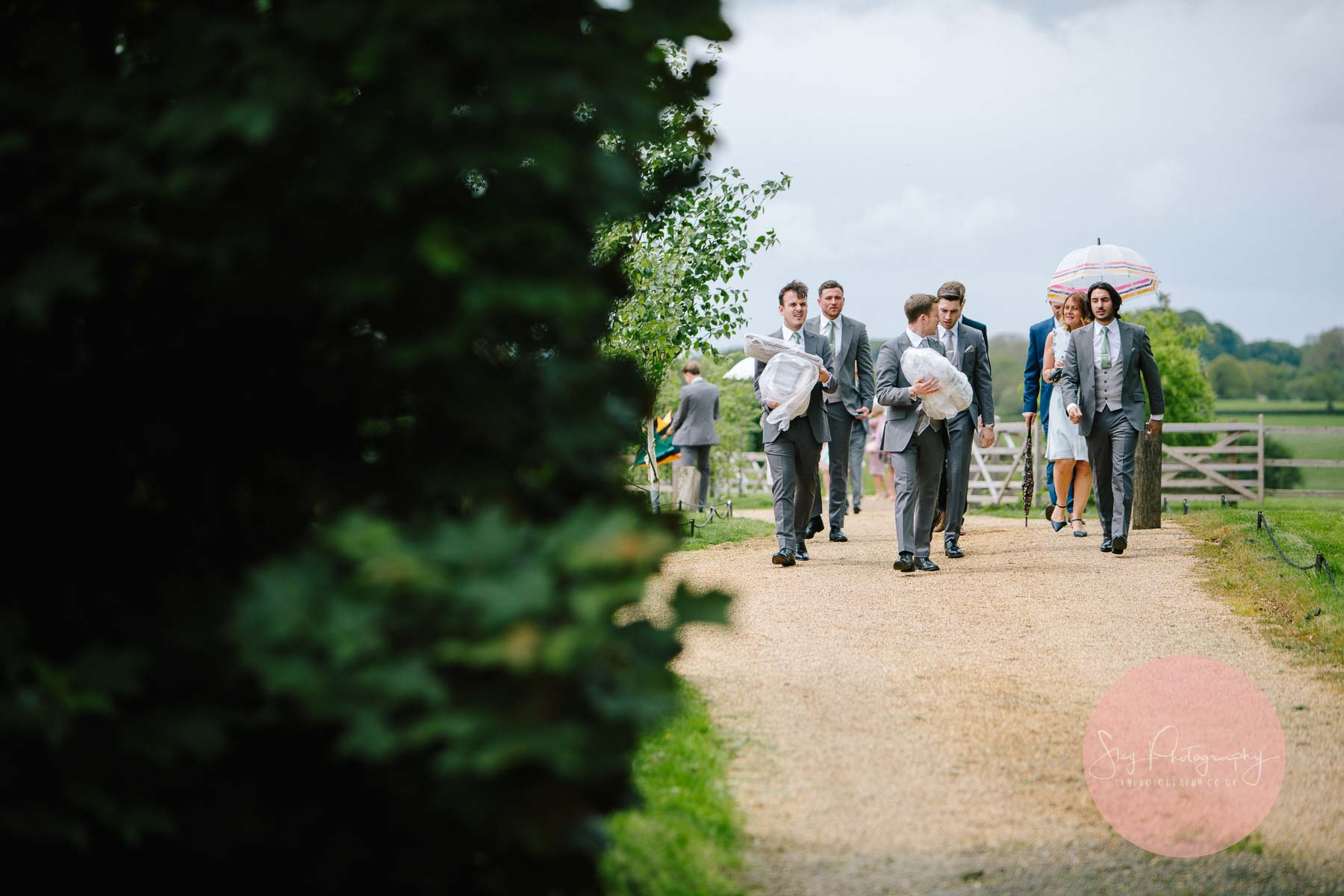 Wedding guests arriving at Dodford Church