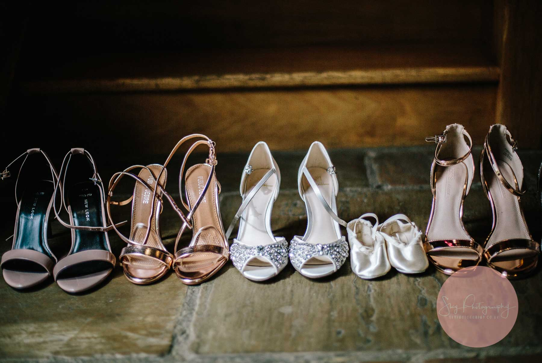 Bride and Bridesmaids shoes lined up against the steps at Dodford Manor