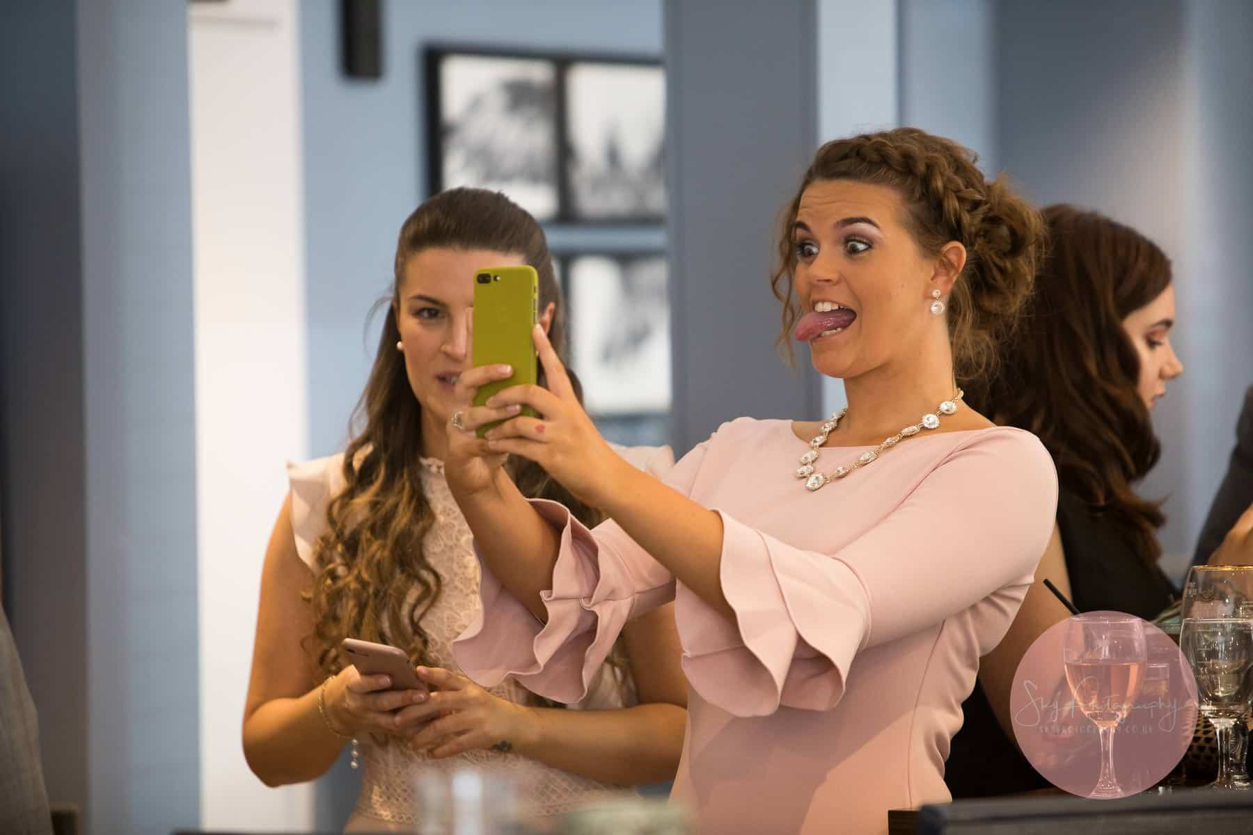Wedding Guest pulling funny face selfies