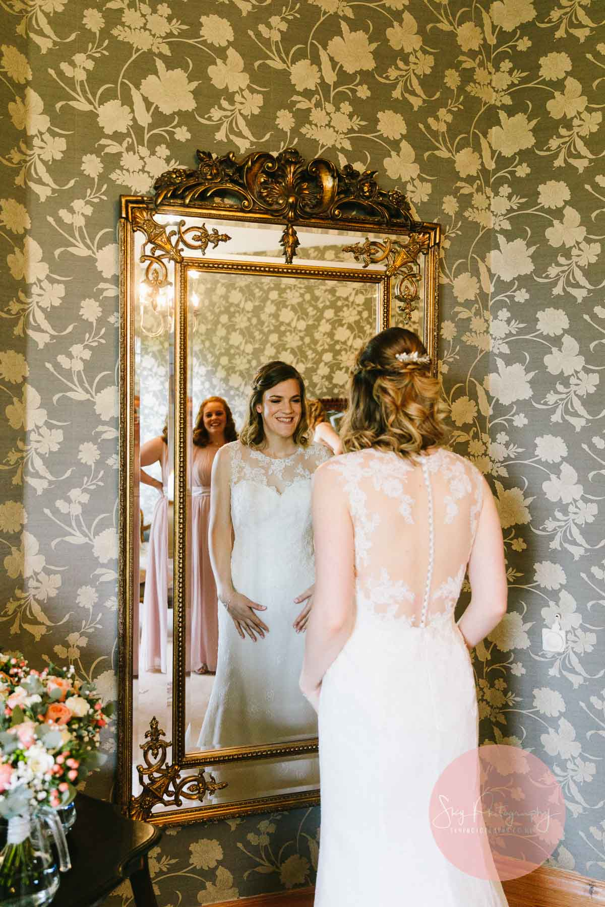 Bride admiring herself in the mirror