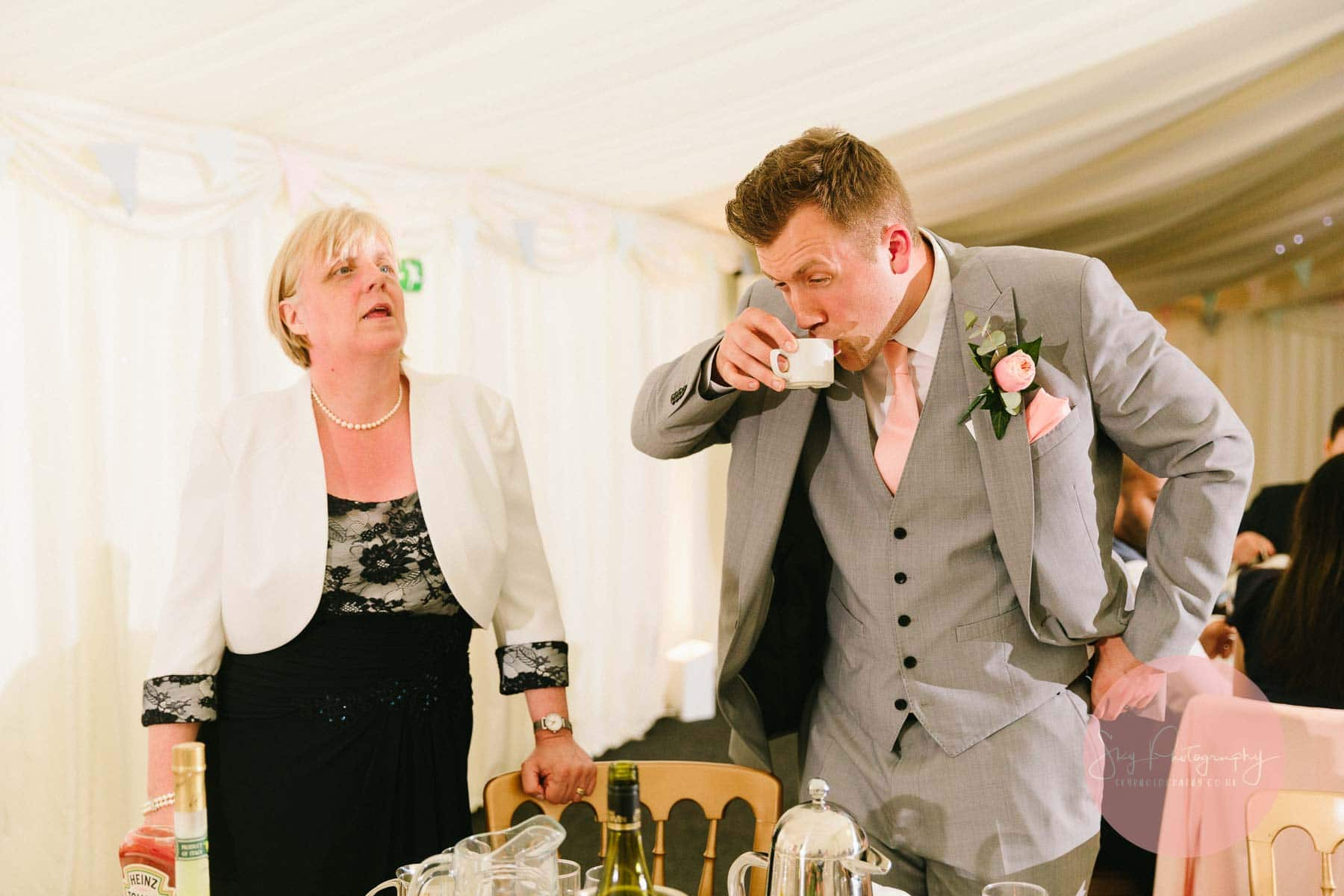 Best man pulling funny face