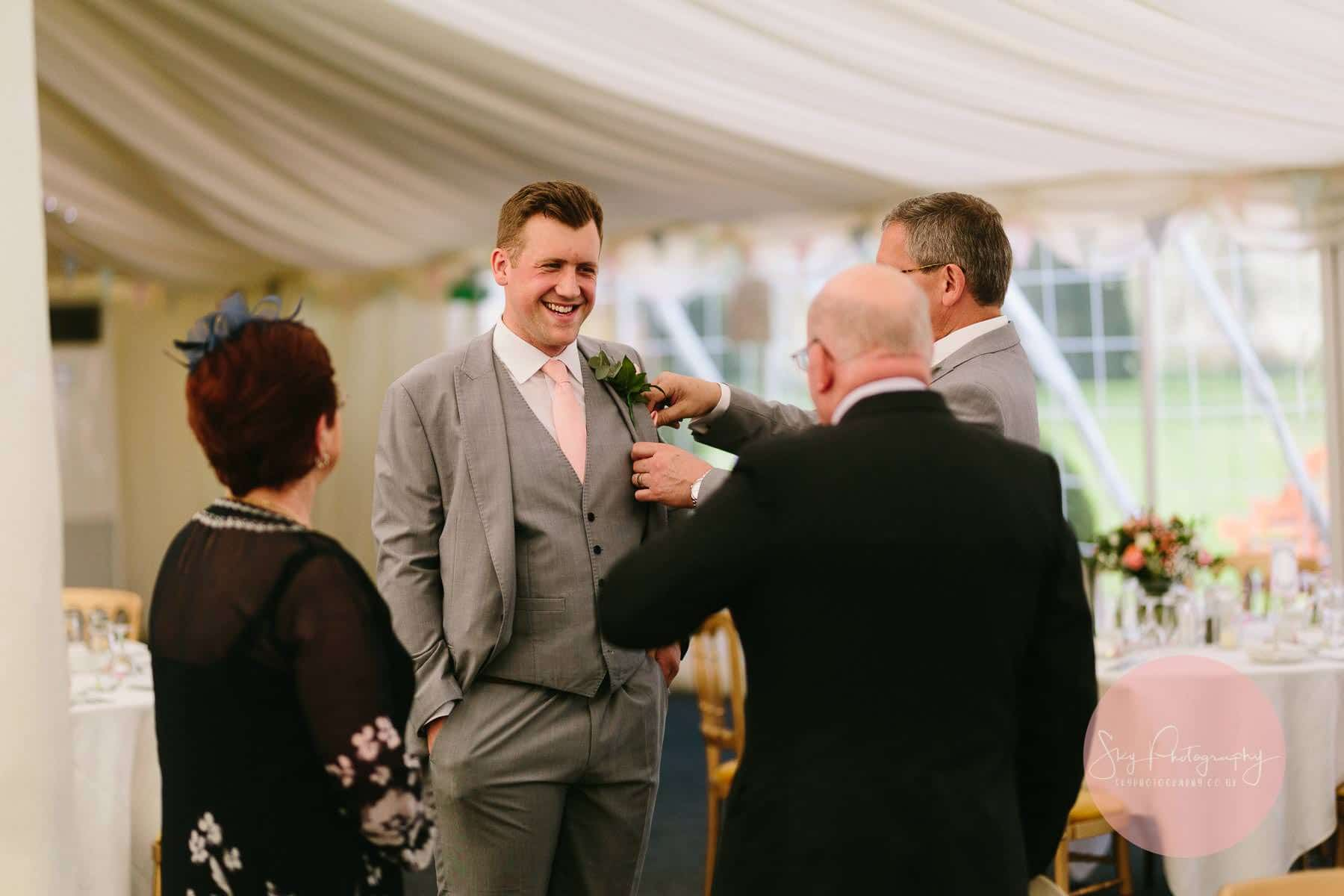 Groom's brother talking with guests