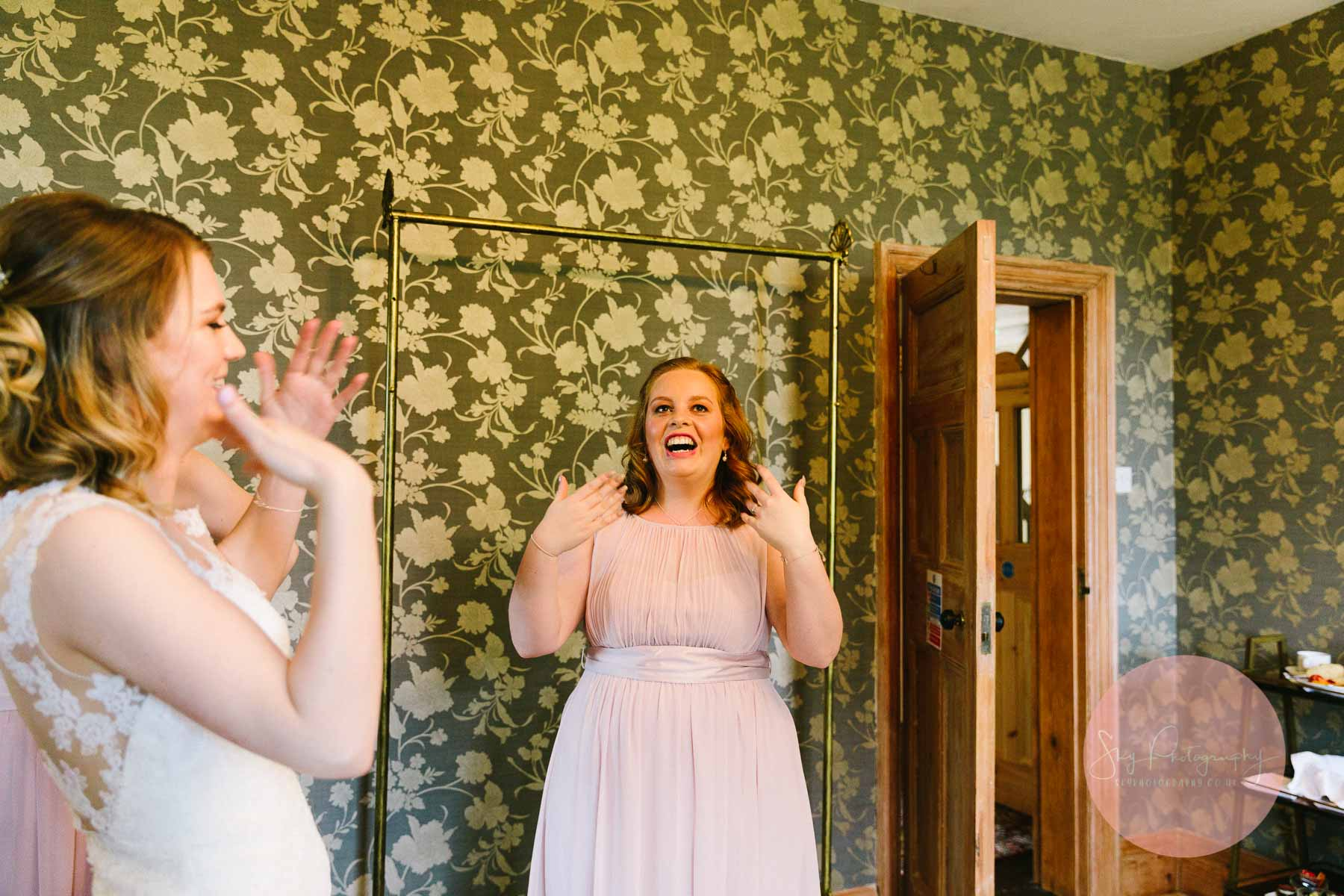 Bridesmaids getting excited in the bridal prep