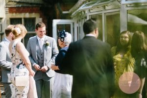 Groom laughing with grandma before getting married