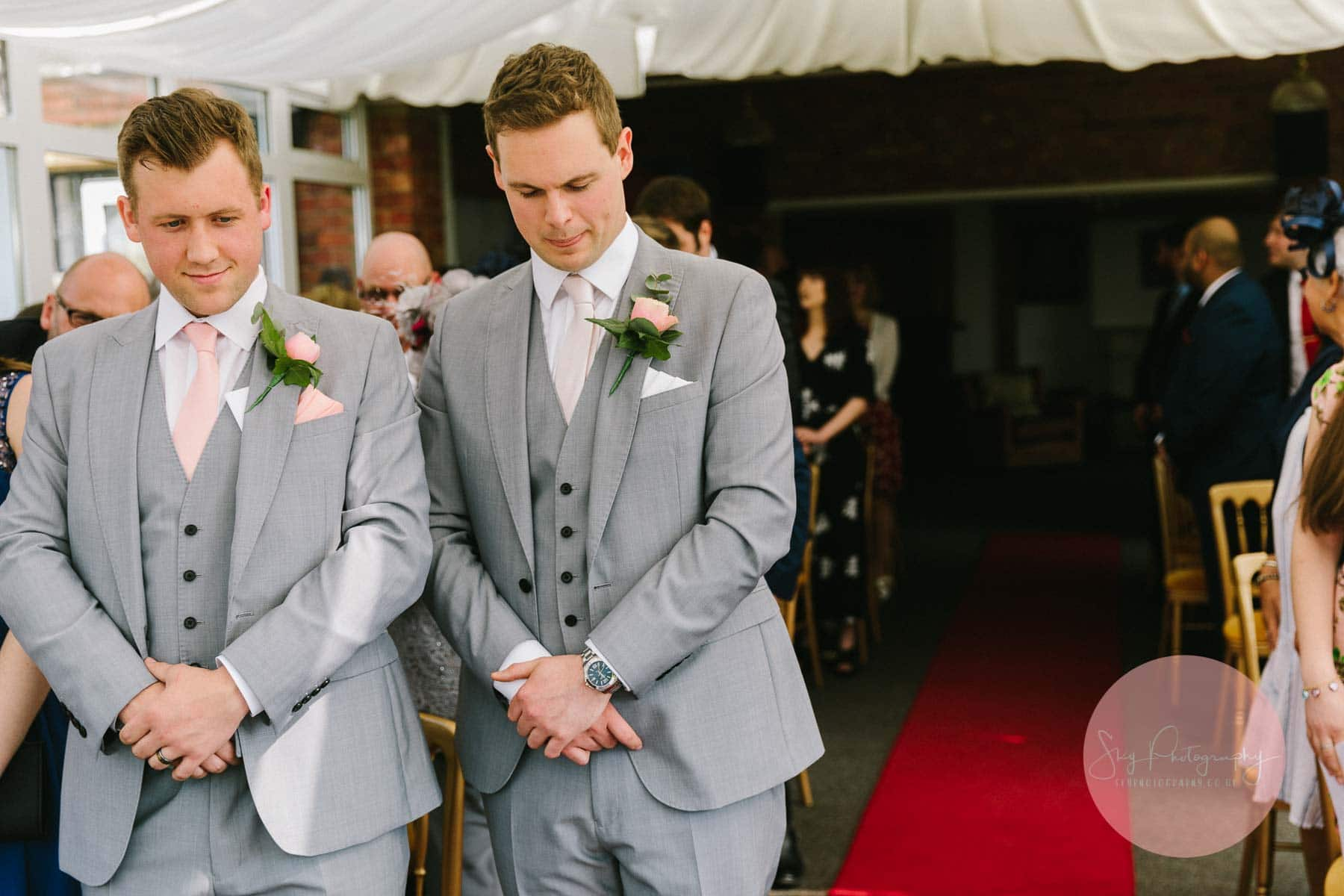 Groom anxiously waiting for bride to come down the aisle