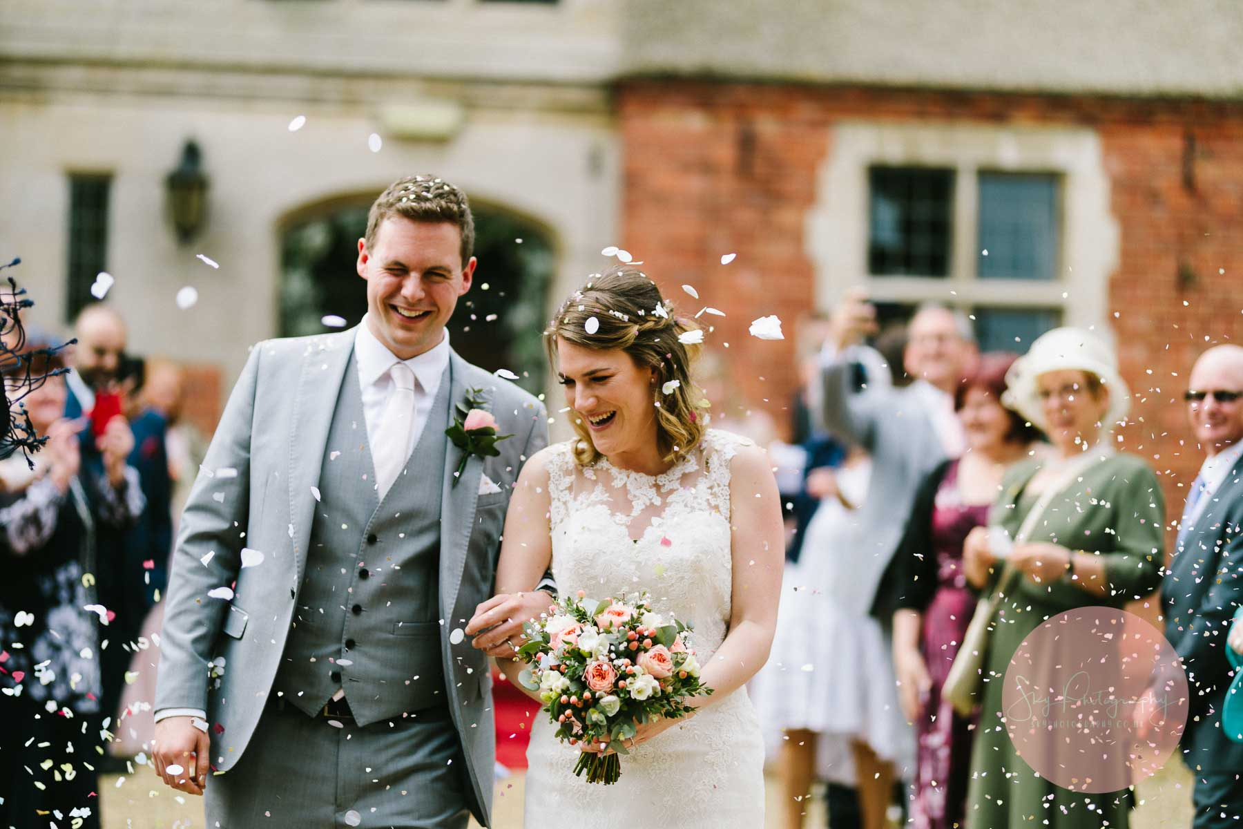 Confetti Photo, bride and groom grimacing