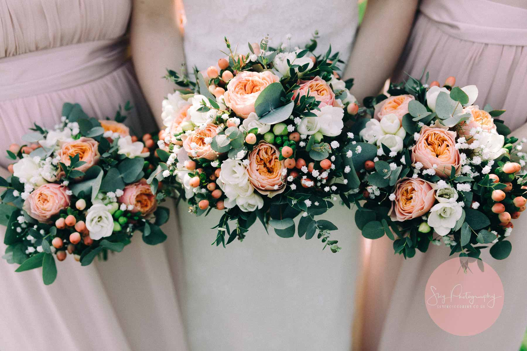 Beautiful bouquets of flowers held by bride and bridesmaids