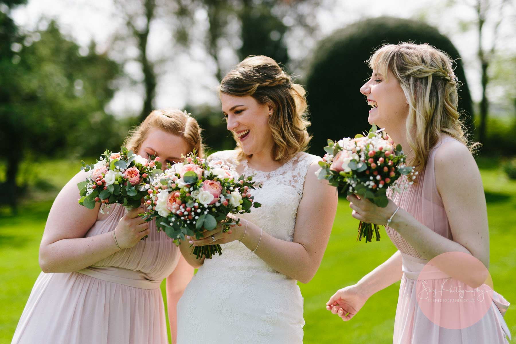 Bridesmaids laughing with flowers