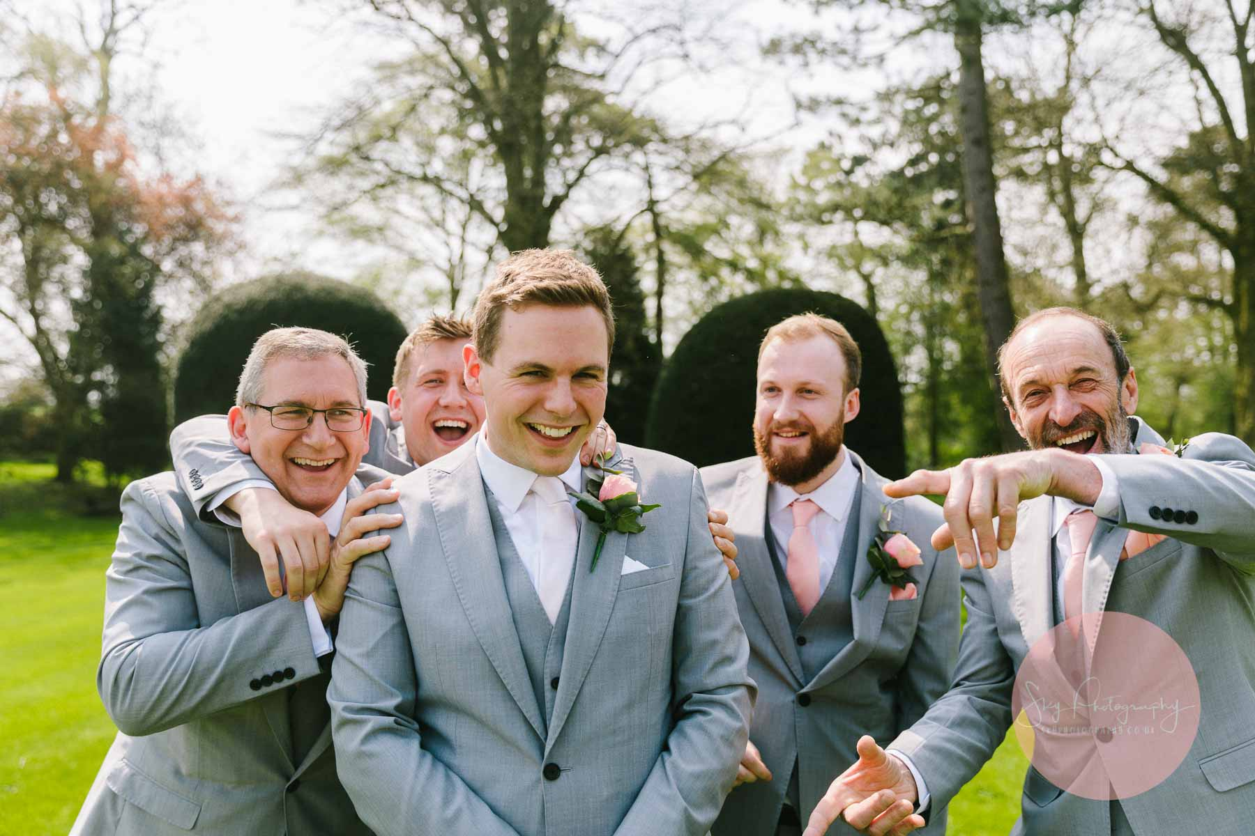 Groom being played with by groomsmen