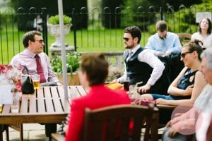 Wedding guests enjoying drinks between ceremony and wedding breakfast