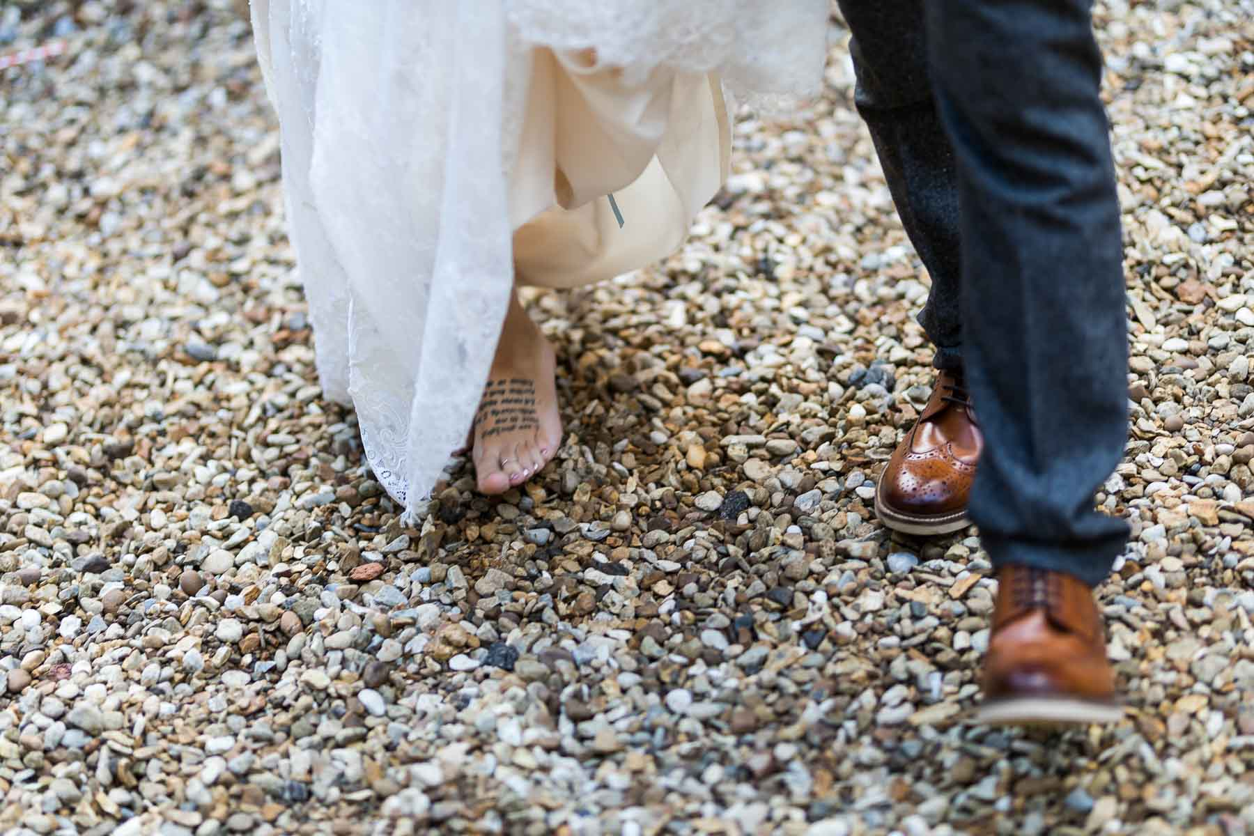 barefoot bride walking towards her wedding