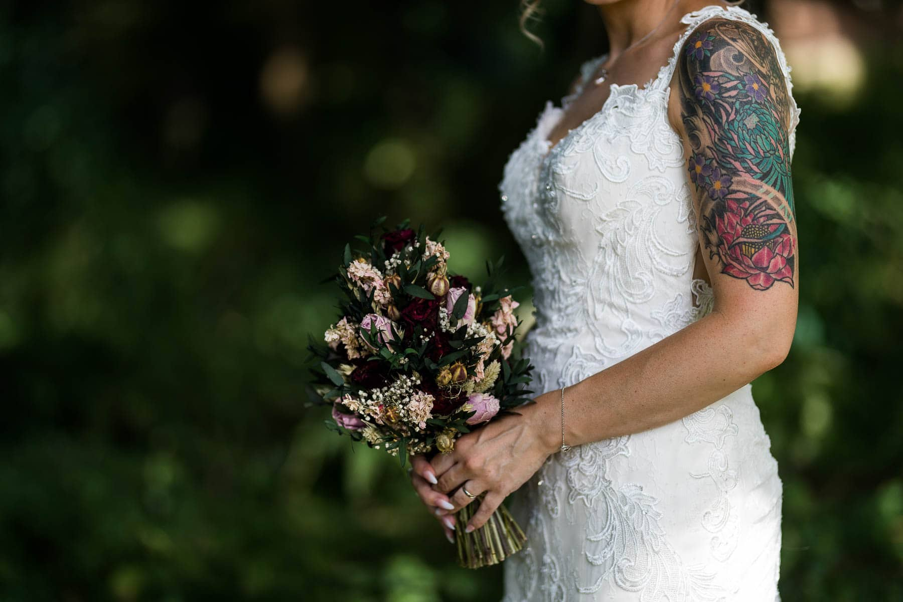 tattooed bride and her ethereal flowers