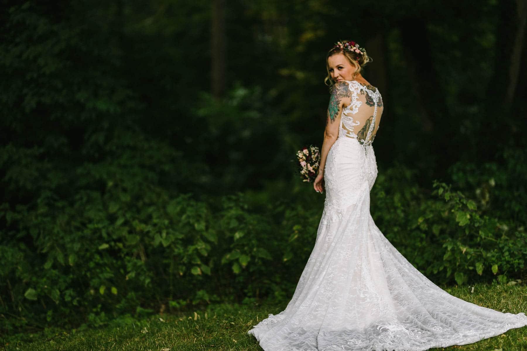 bride turning back towards the camera looking at the camera