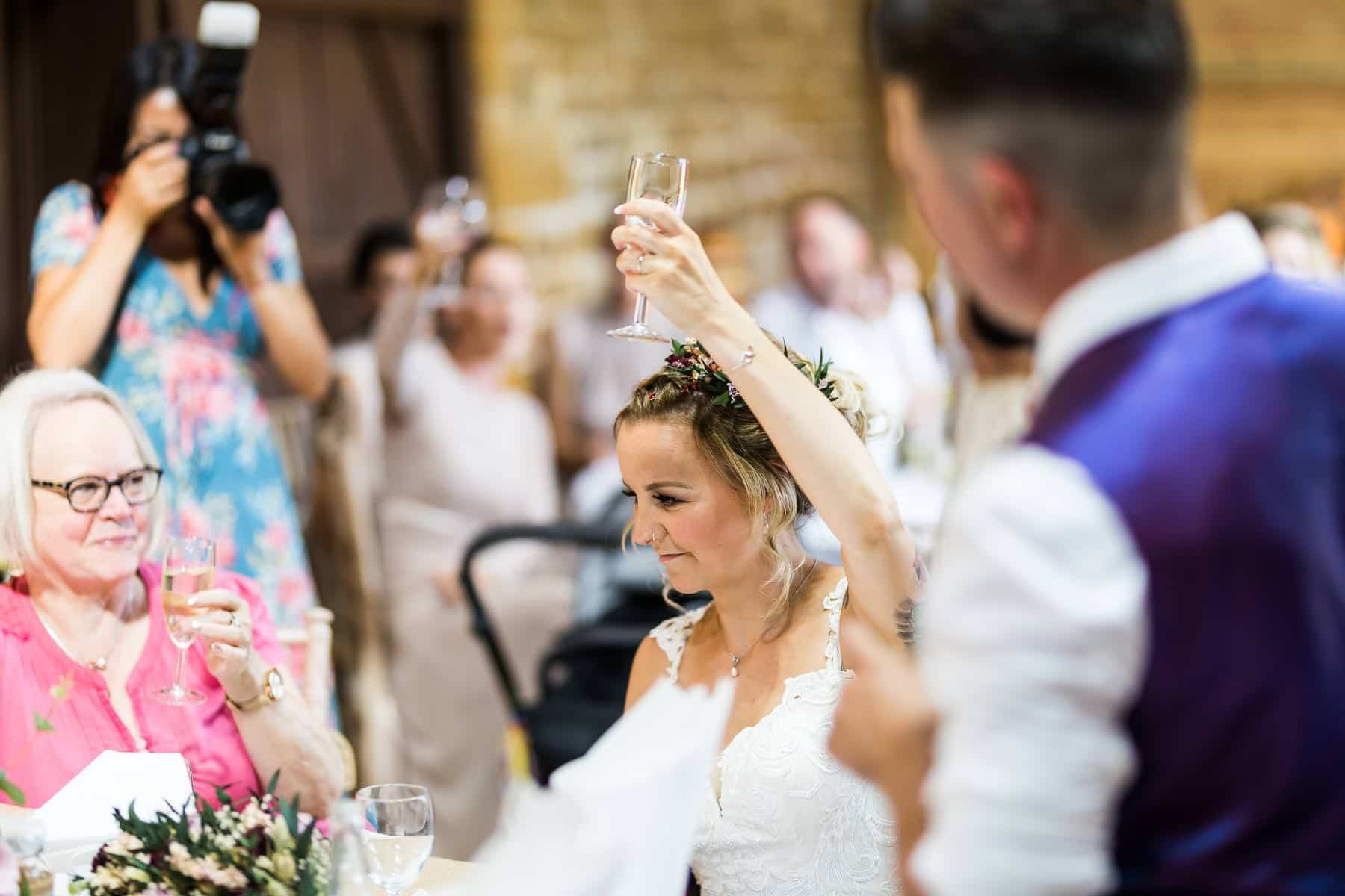 Bride cheers to her groom