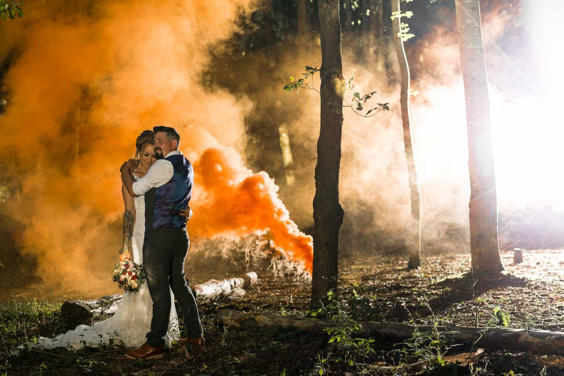 Wedding photo of a bride using enola gaye smoke grenade