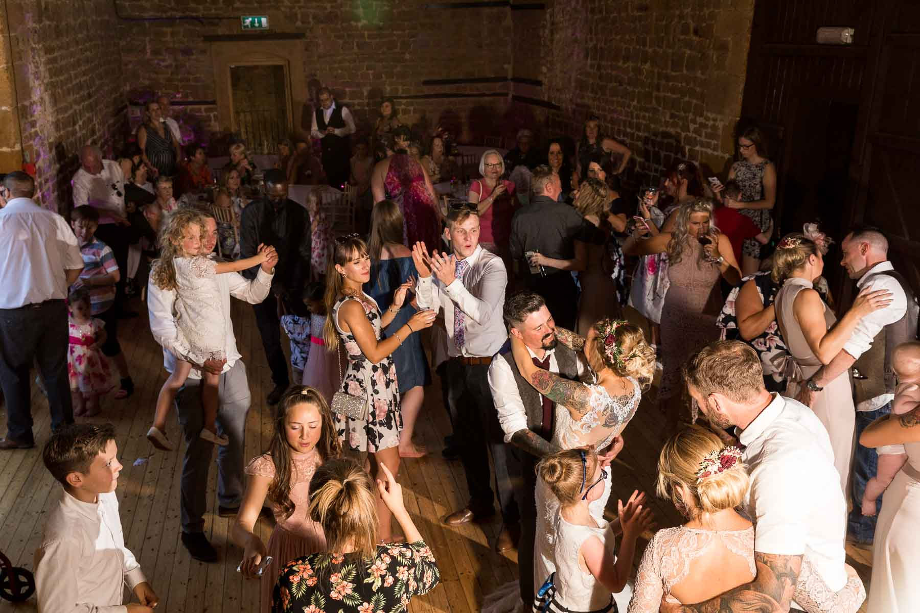 Wedding party on the dance floor at the barns hunsburry