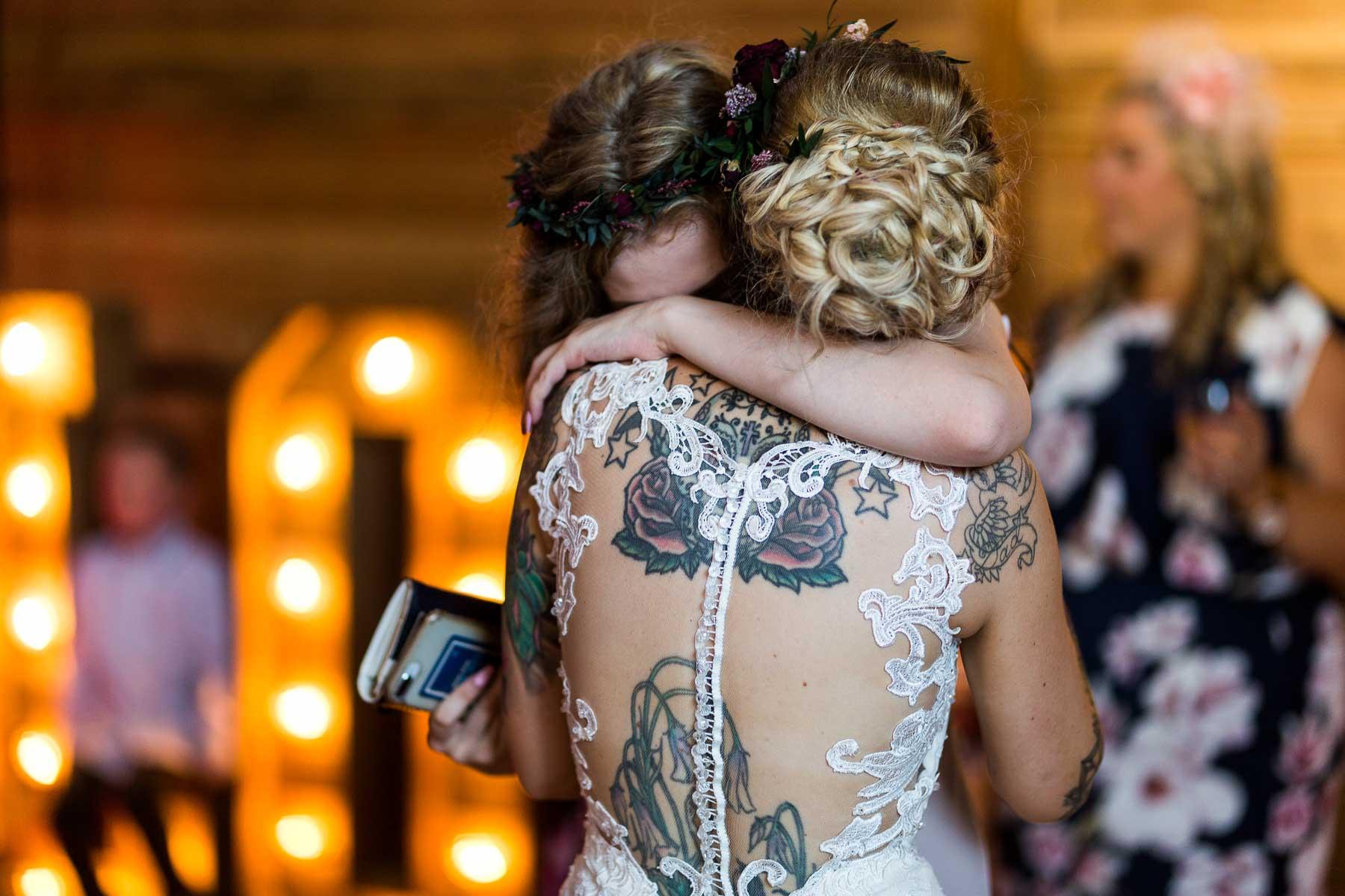 Bride embracing her daughter on the dance floor