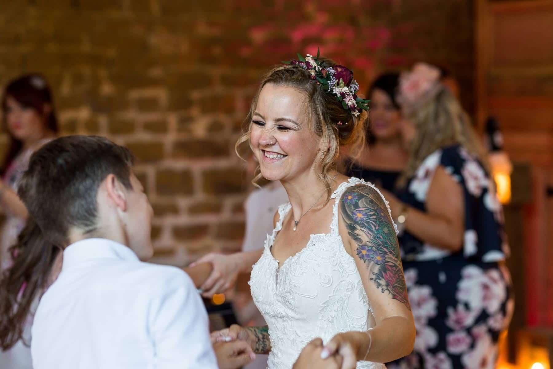 Bride smiling on the dance floor