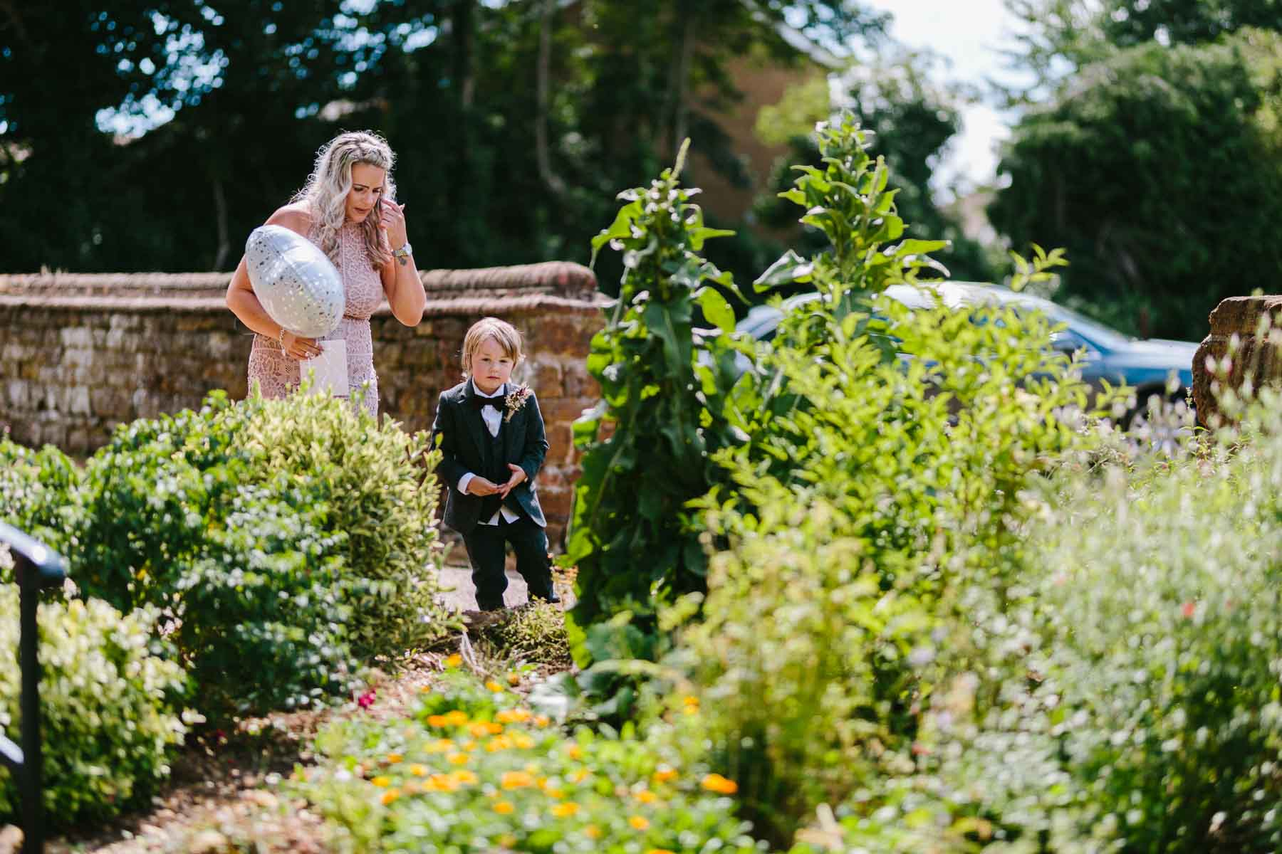 page boy running in the garden