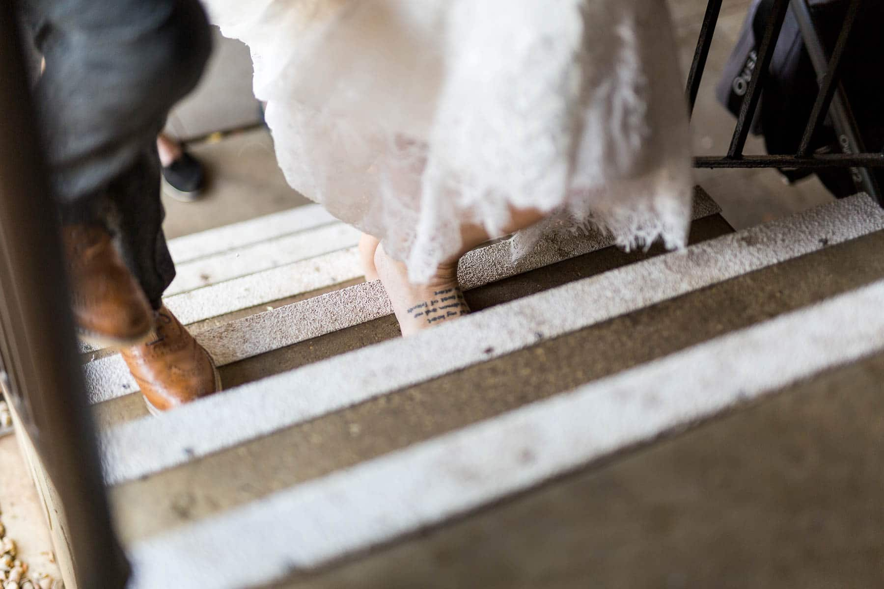barefoot bride walking to the aisle