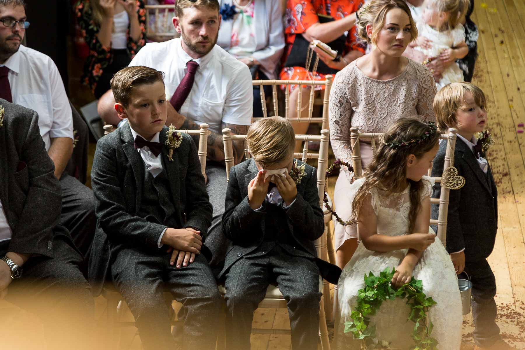 pageboy kissing as seeing his parents getting married