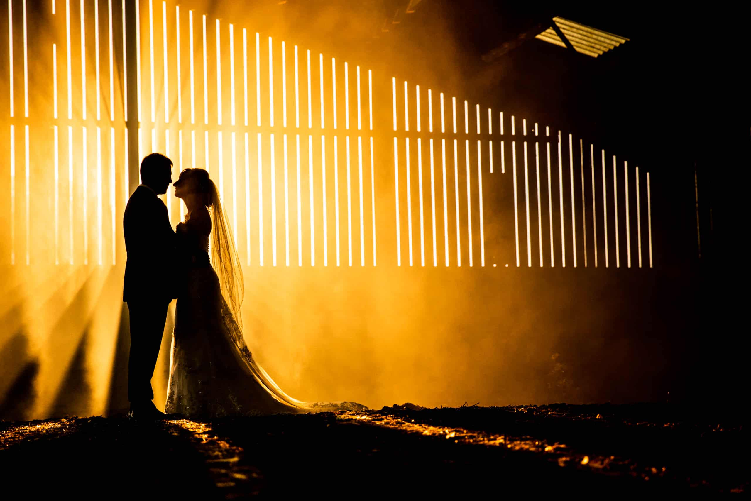 Bride and groom kissing in an Incredible barn wedding photo at Woodfarm wedding photographers northamptonshire