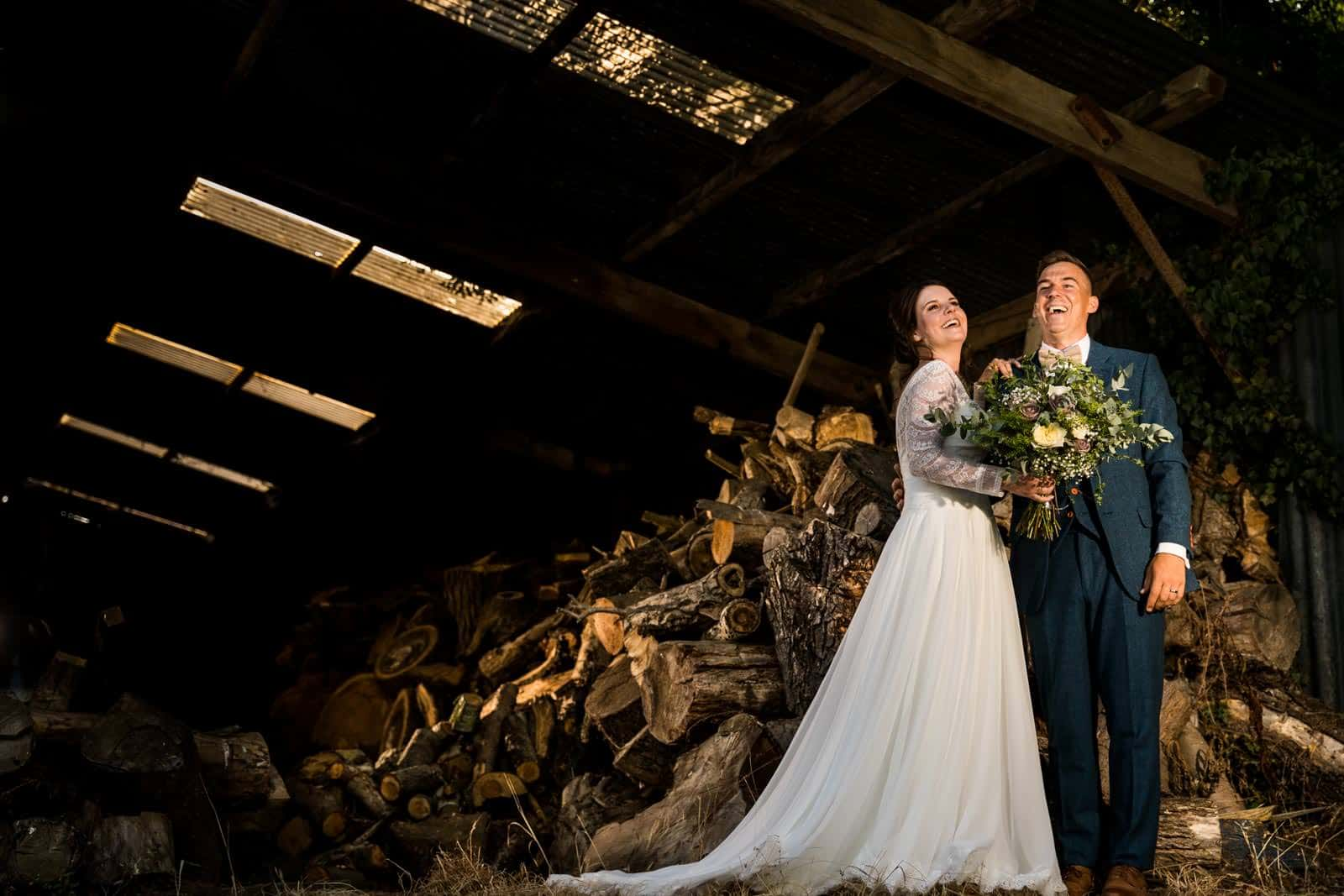 Bassmead wedding photography of couple standing in the wood store