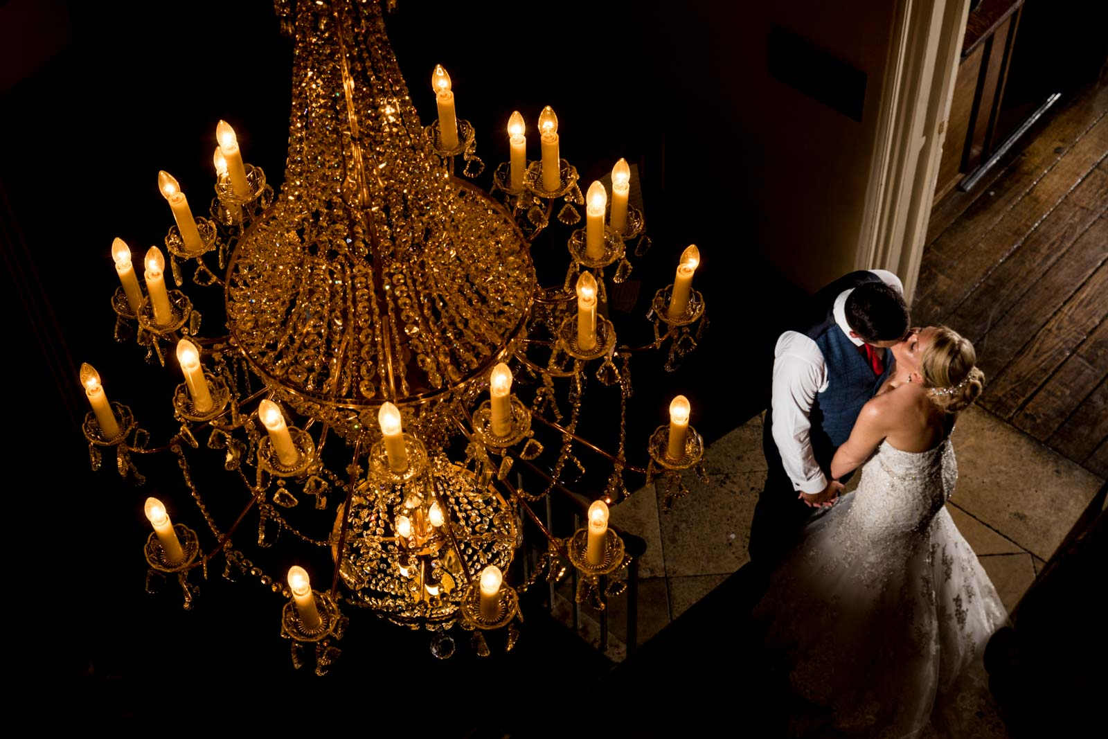 Beautiful chandelier photo taken of the couple kissing at offley place