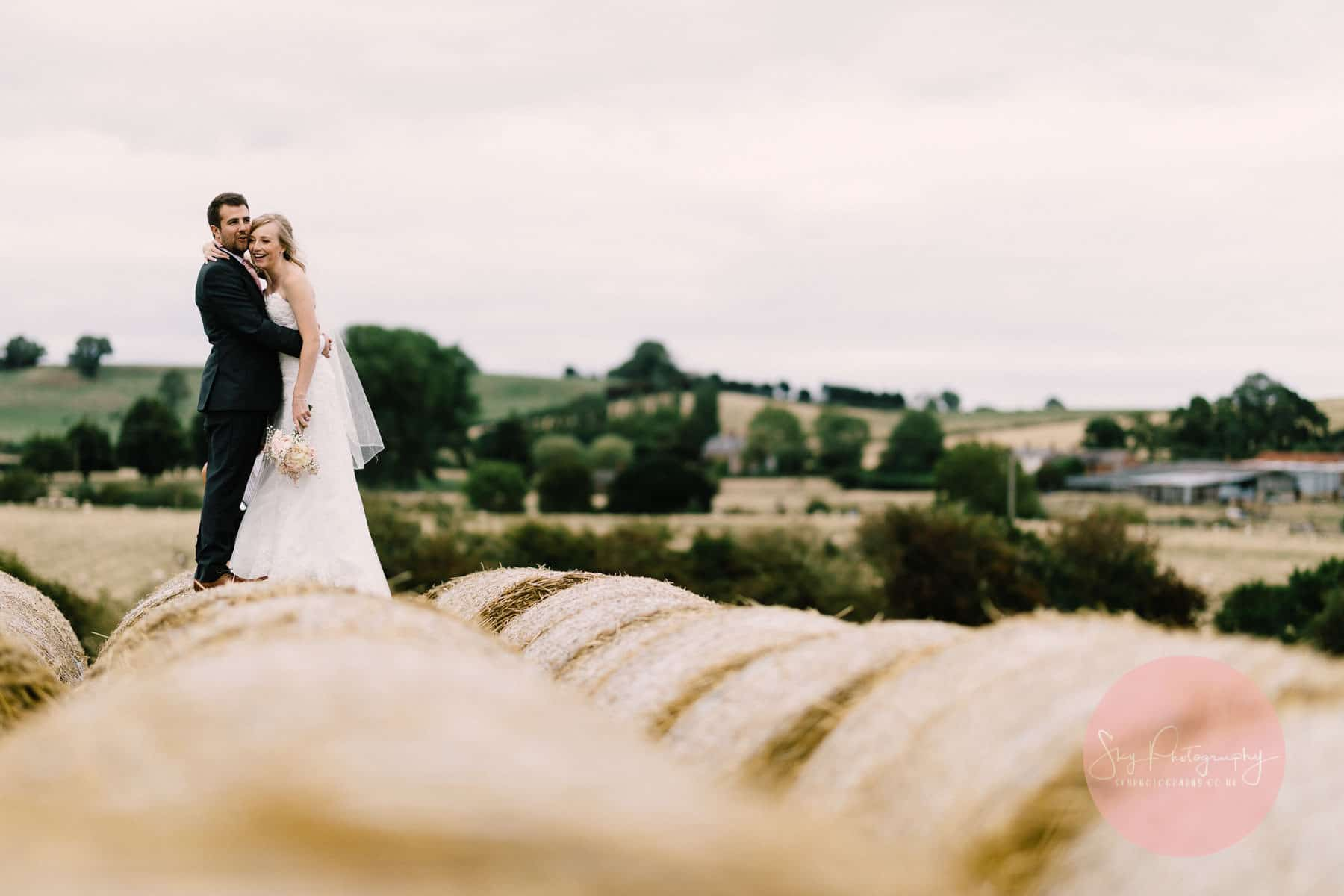 Wood Farm Everdon Wedding Photography on top of hay bales