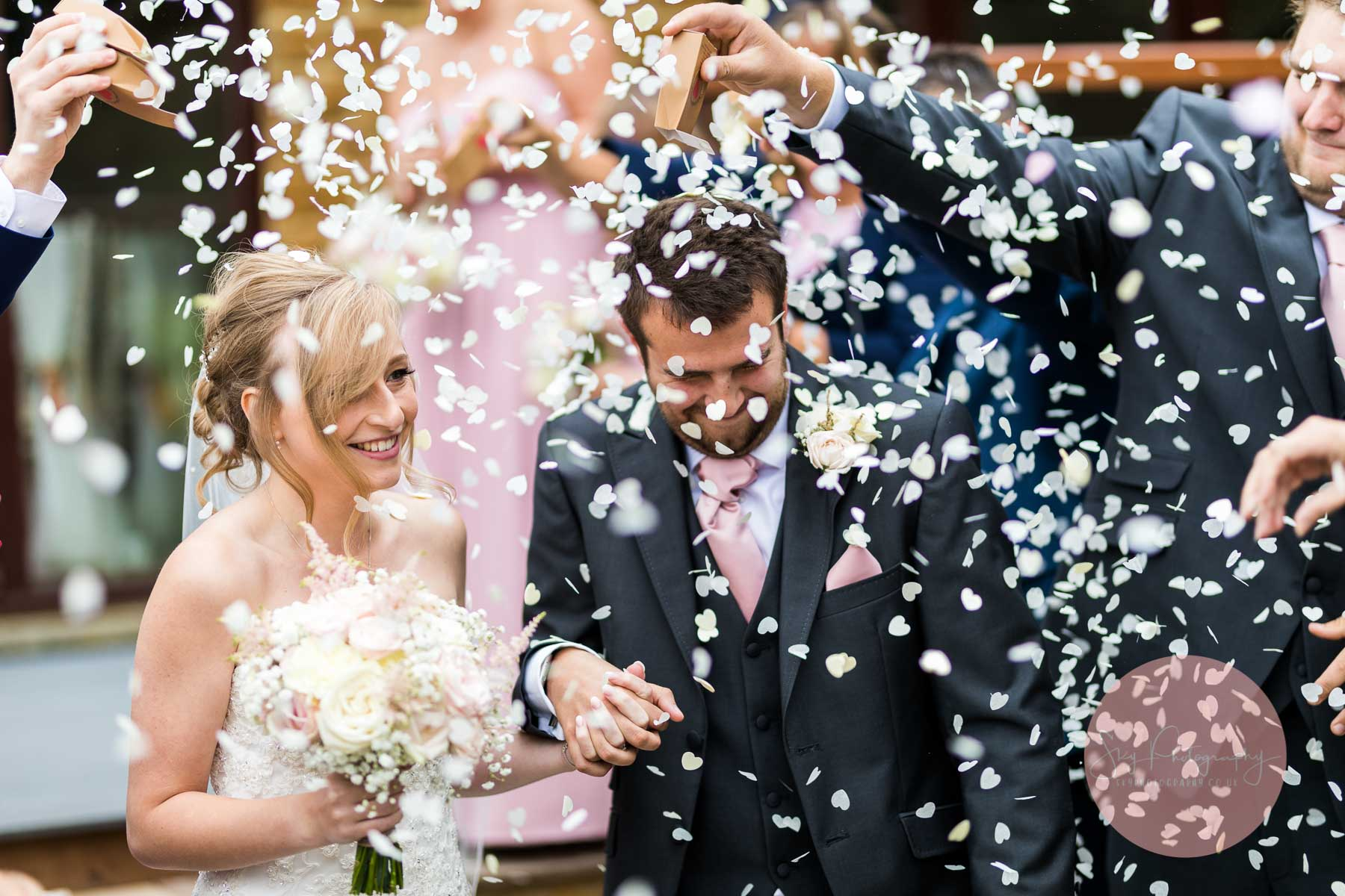 confetti being thrown by guests at wood farm