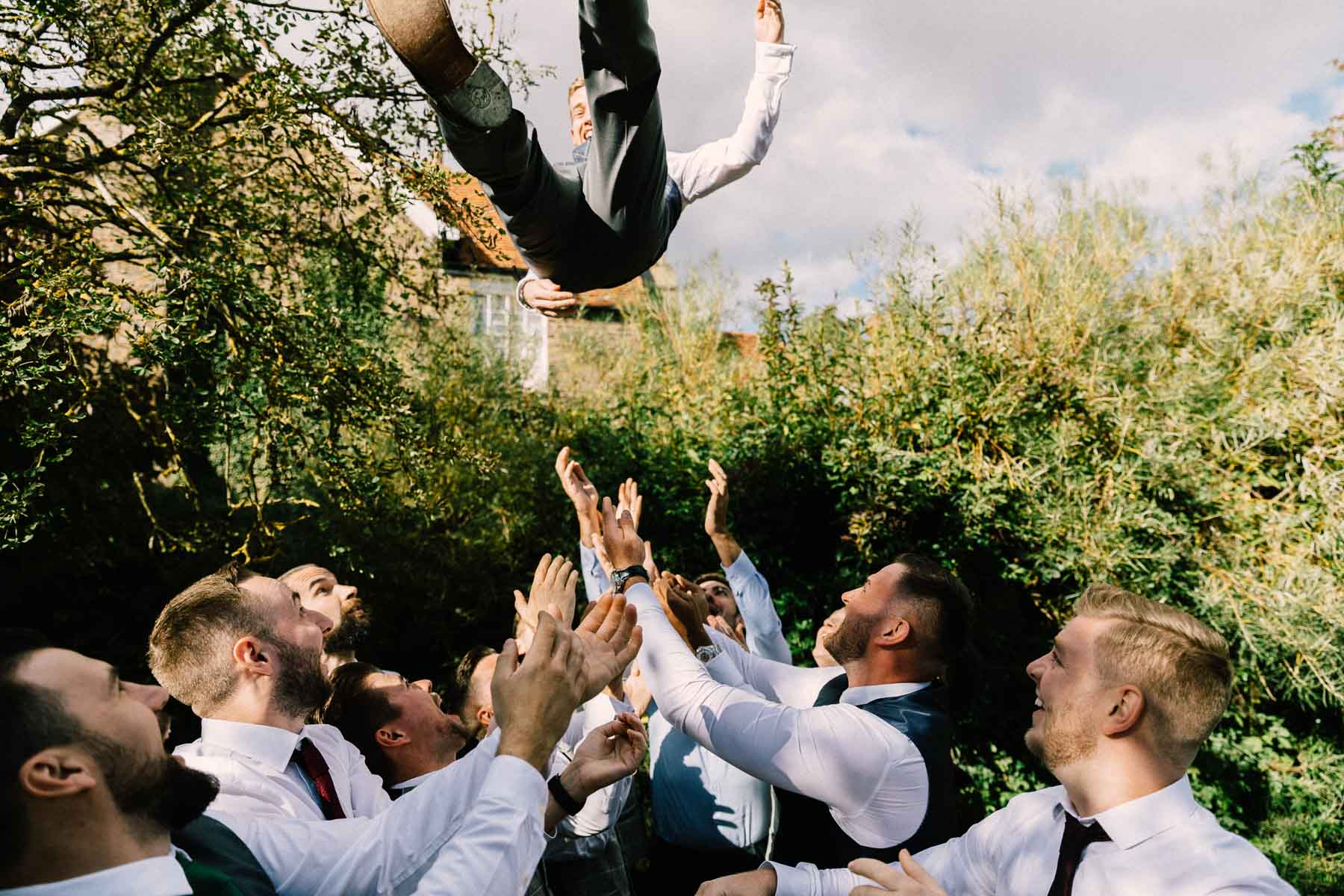 groom being thrown high
