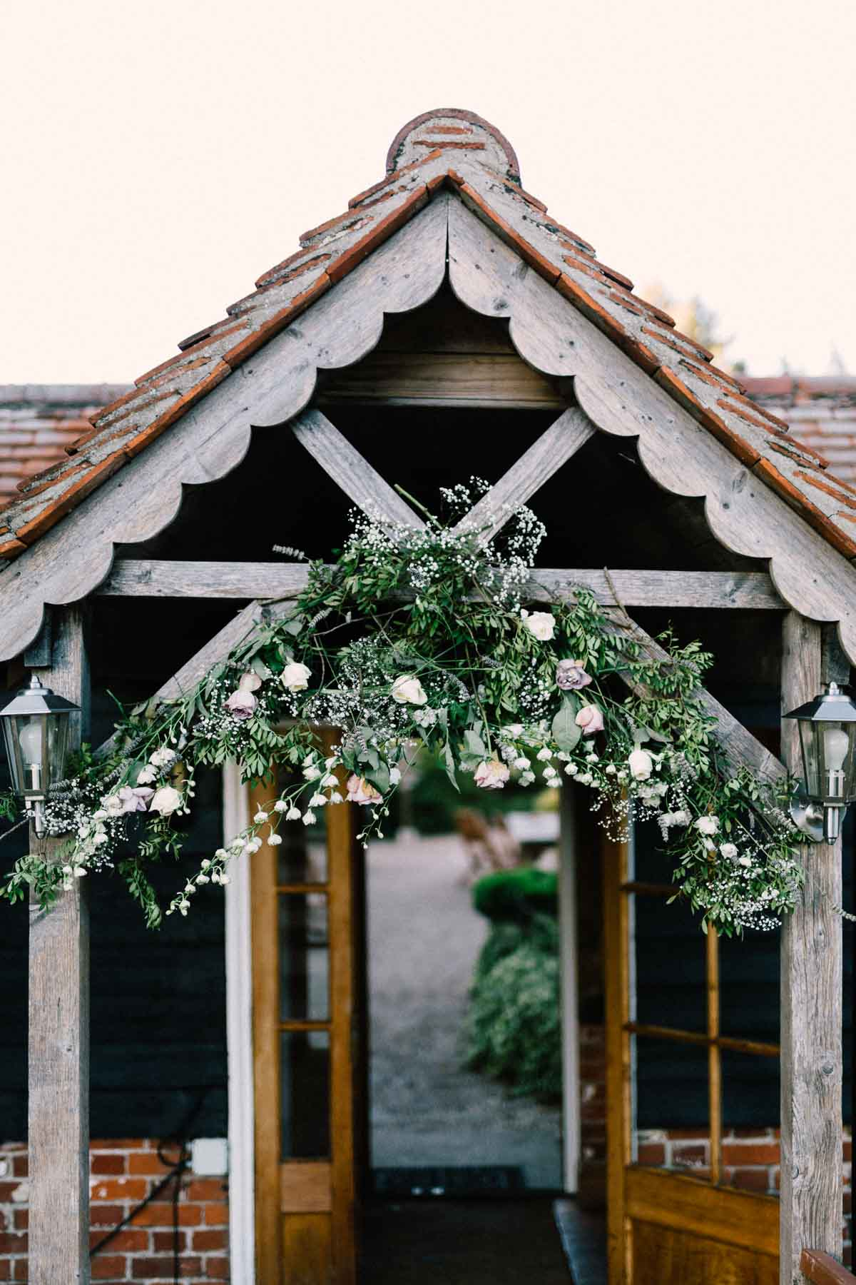 Floral ideas at a wedding hanging from a door
