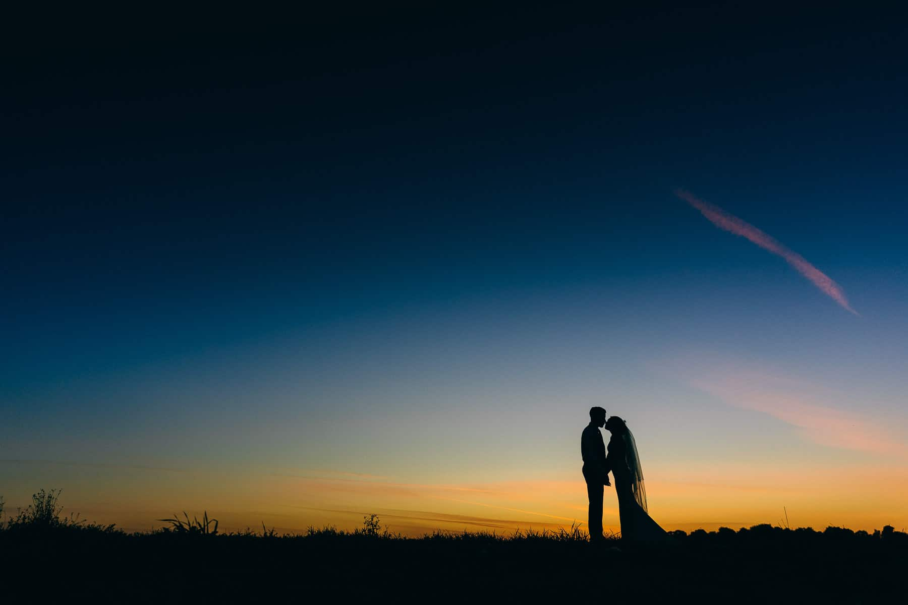 Stunning Silhouette wedding photography after sun down dusk