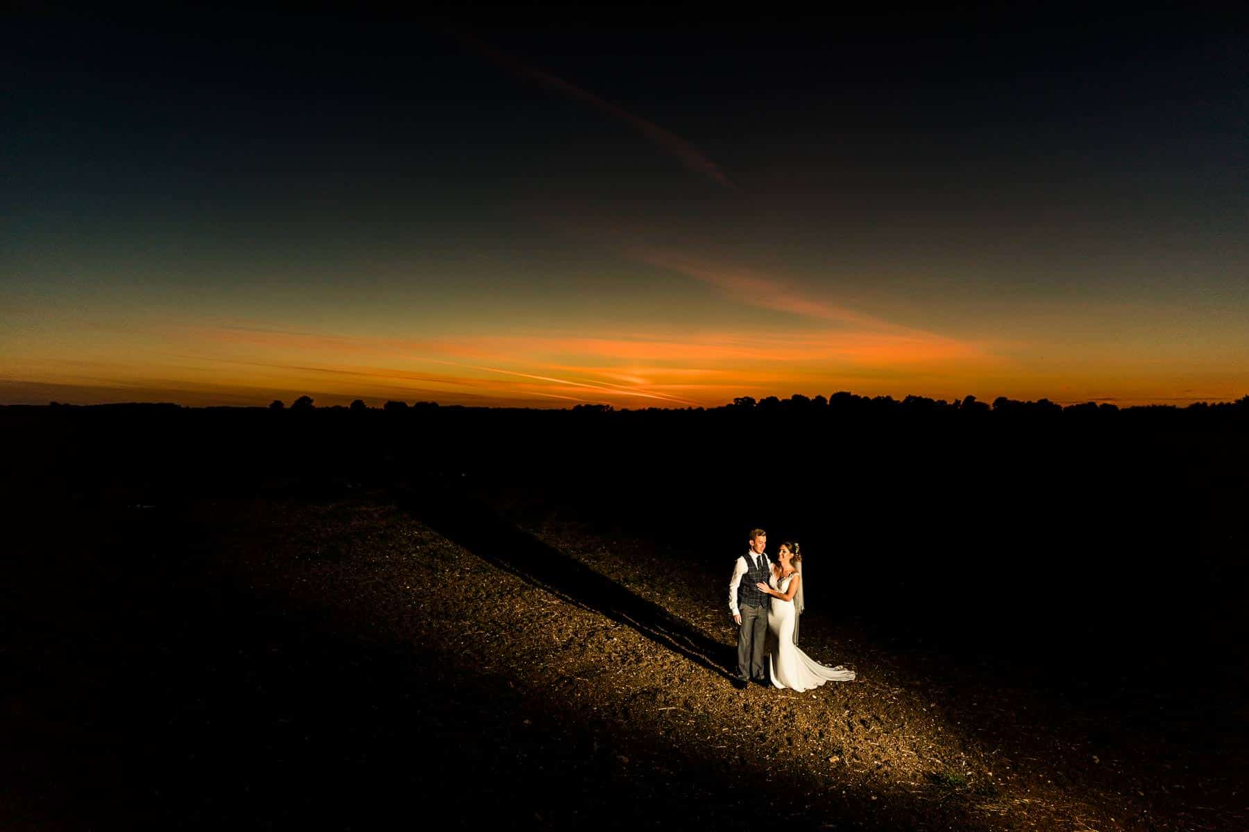 Stunning dusk photos of the wedding couple