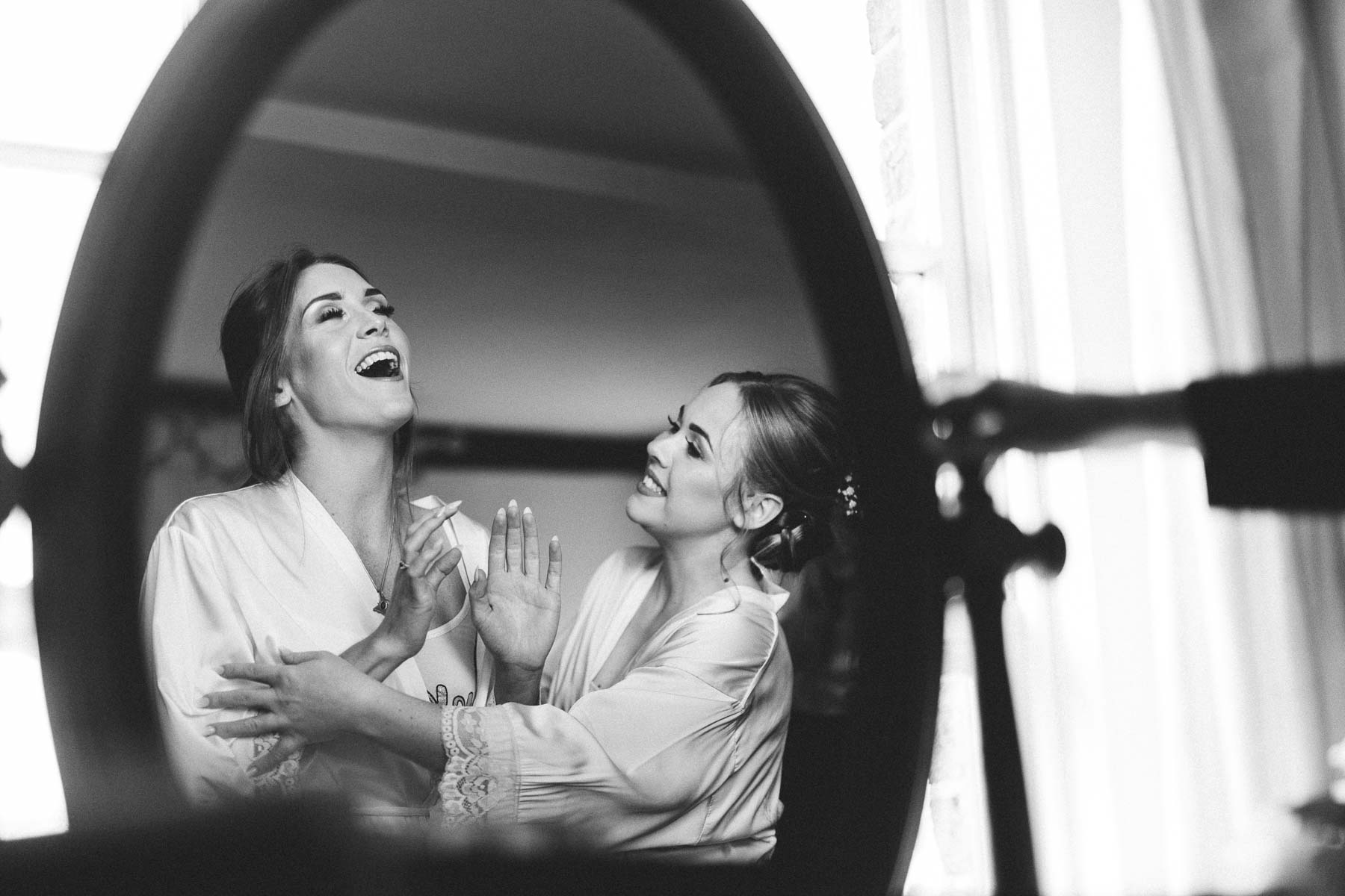 Bridesmaids having fun in the bride preparations at the reid Rooms