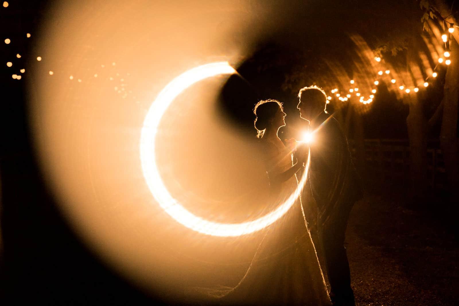 Woodfarm entrance lights used to illuminate couple at night