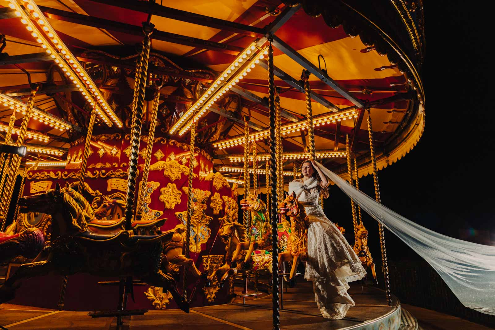 Wicksteed park wedding photography Bride on her own enjoying riding the carousel at wicksteed park
