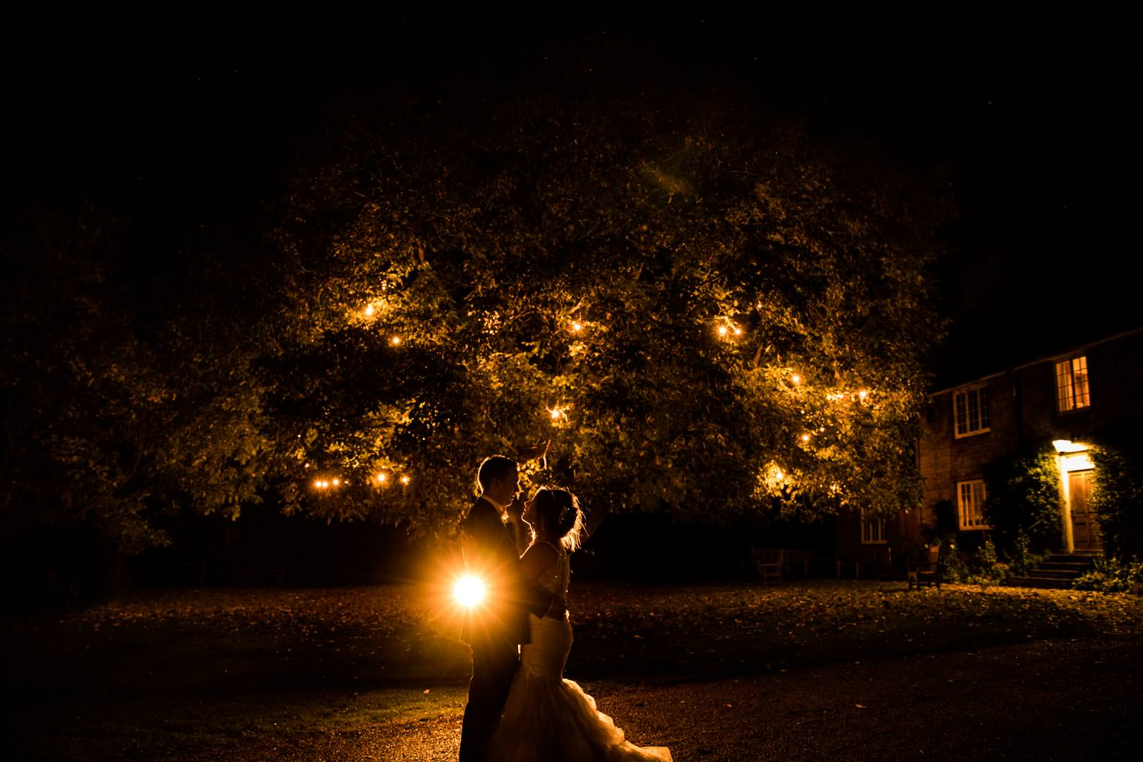 Couple standing under the tree at Crockwell Farm winter wedding